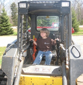 Carson in the Skid Steer