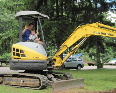 Mikaela helping Matt with the Back Hoe